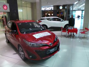 CMH-Toyota-Alberton-display-of-the-New-Yaris-with-sales-exec-in-background