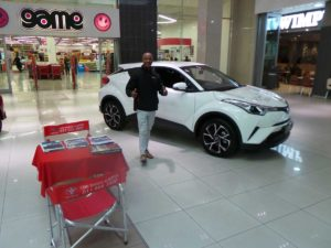 CMH-Toyota-Alberton-display-with-sales-executive-at-the-display-of-the-C-HR