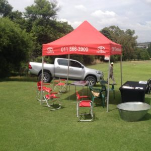 CMH Toyota Alberton at Bell Equipment Golf Day, Water hole with Toyota Hilux silver