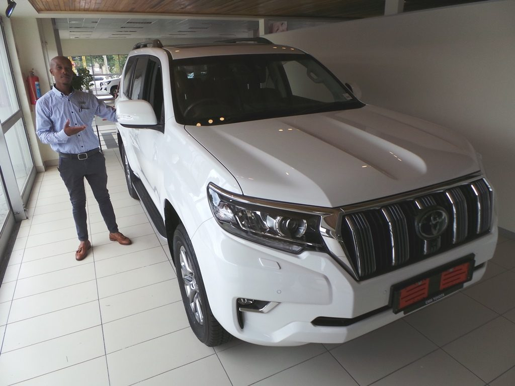 Toyota Alberton- Sales executive Lonwabo with the Toyta Prado white